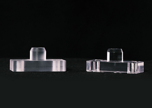 CNC Milled Acrylic Pivot Stops.  These part then get Vapor Polished, which is a chemical that hits the acrylic material, clears the